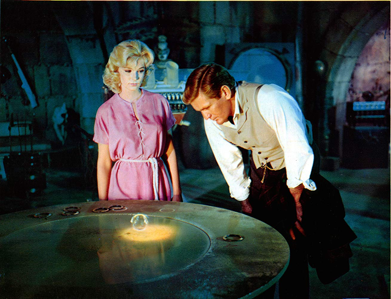 Weena (Yvette Mimieux) shows George (Rod Taylor) the history ring in The Time Machine (1960)