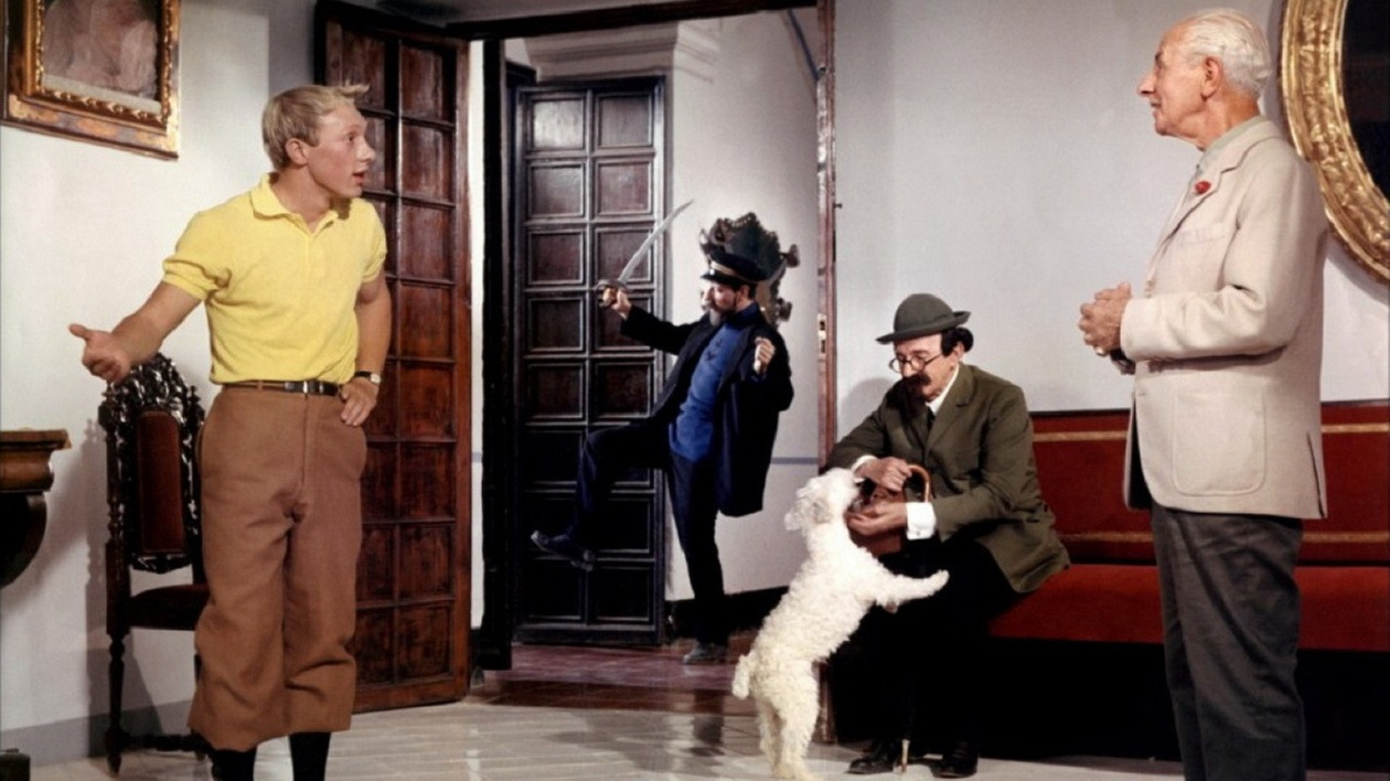 (l to r) Tintin (Jean-Pierre Talbot), Captain Haddock (Jean Bouise), Snowy, Professor Calculus (Felix Fernandez) and Nestor (Max Elloy) in Tintin and the Blue Oranges (1965)