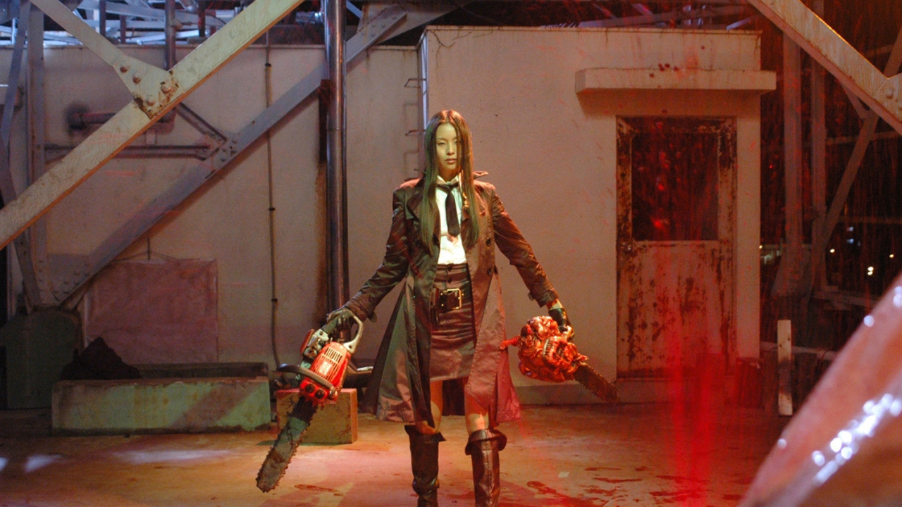 Eihi Shiina heads into action with chainsaws at the ready in Tokyo Gore Police (2008)