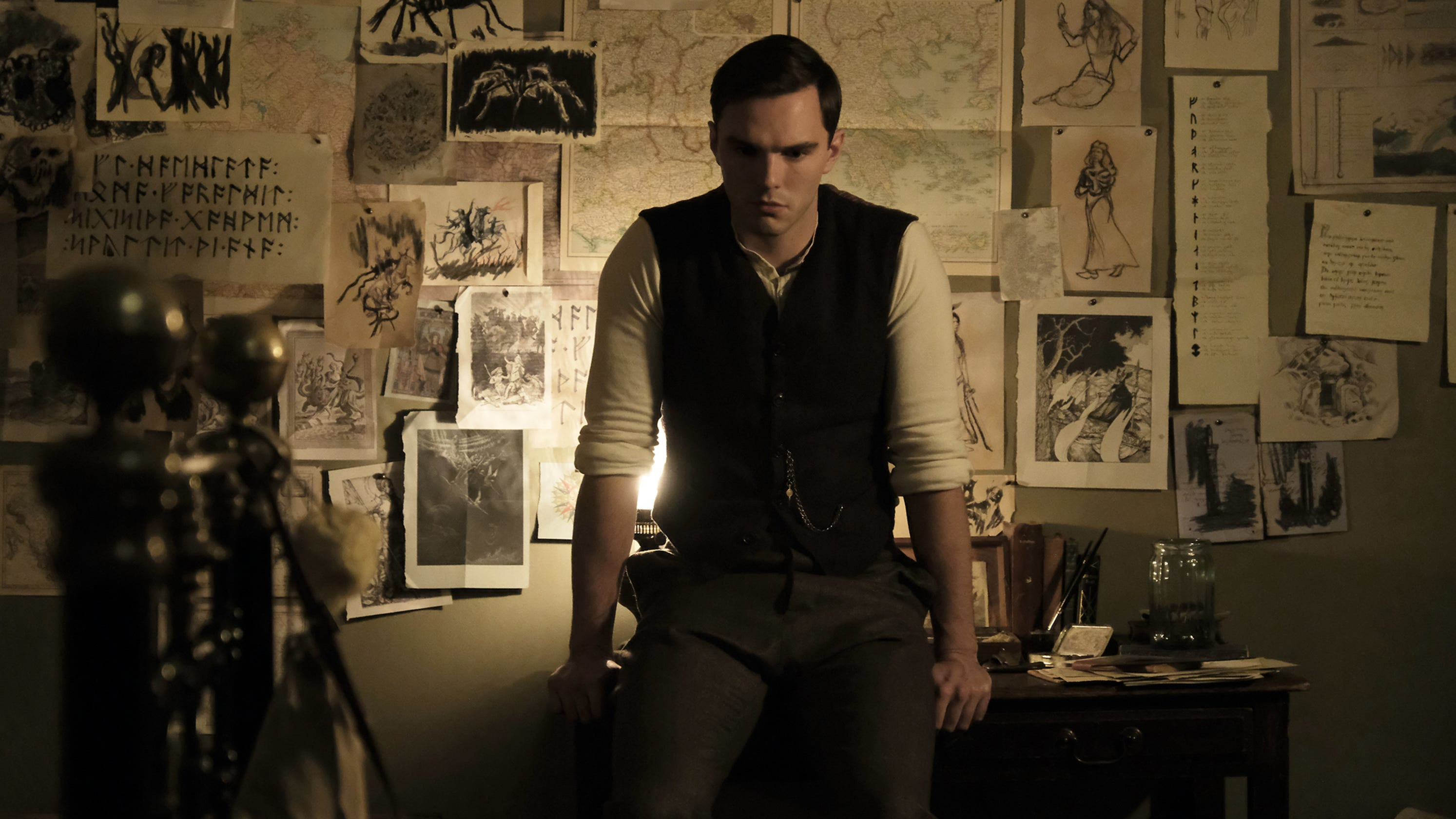 J.R.R. Tolkien (Nicholas Hoult) in his rooms at Oxford in Tolkien (2019)