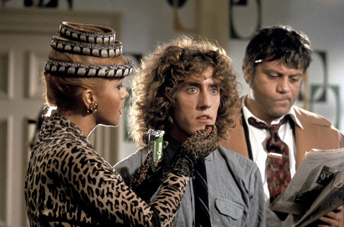 Tommy (Roger Daltrey) (c) flanked by his mother (Ann-Margret) and Cousin Frank (Oliver Reed) in Tommy (1975)