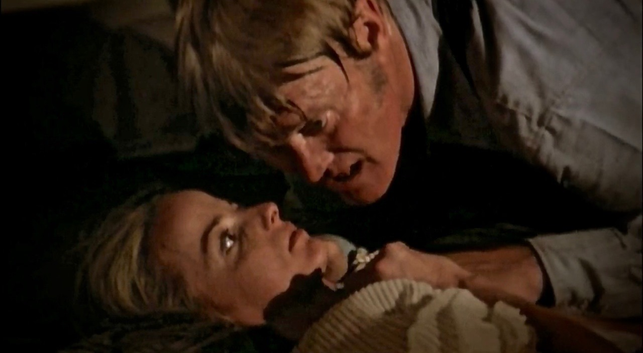 Backwoods psycho Chuck Connors with an imprisoned Jocelyn Jones in Tourist Trap (1979)