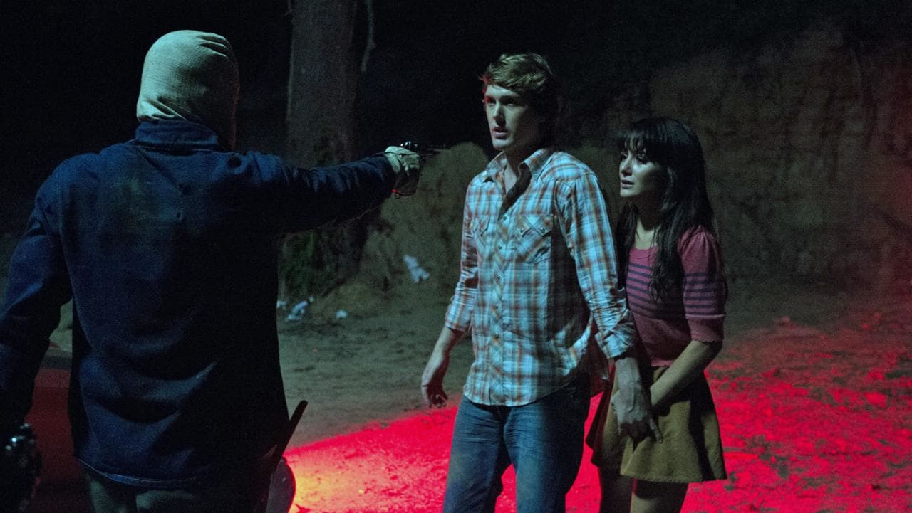 The new Phantom Killer menaces Spencer Treat Clark and Addison Timlin in The Town That Dreaded Sundown (2014)