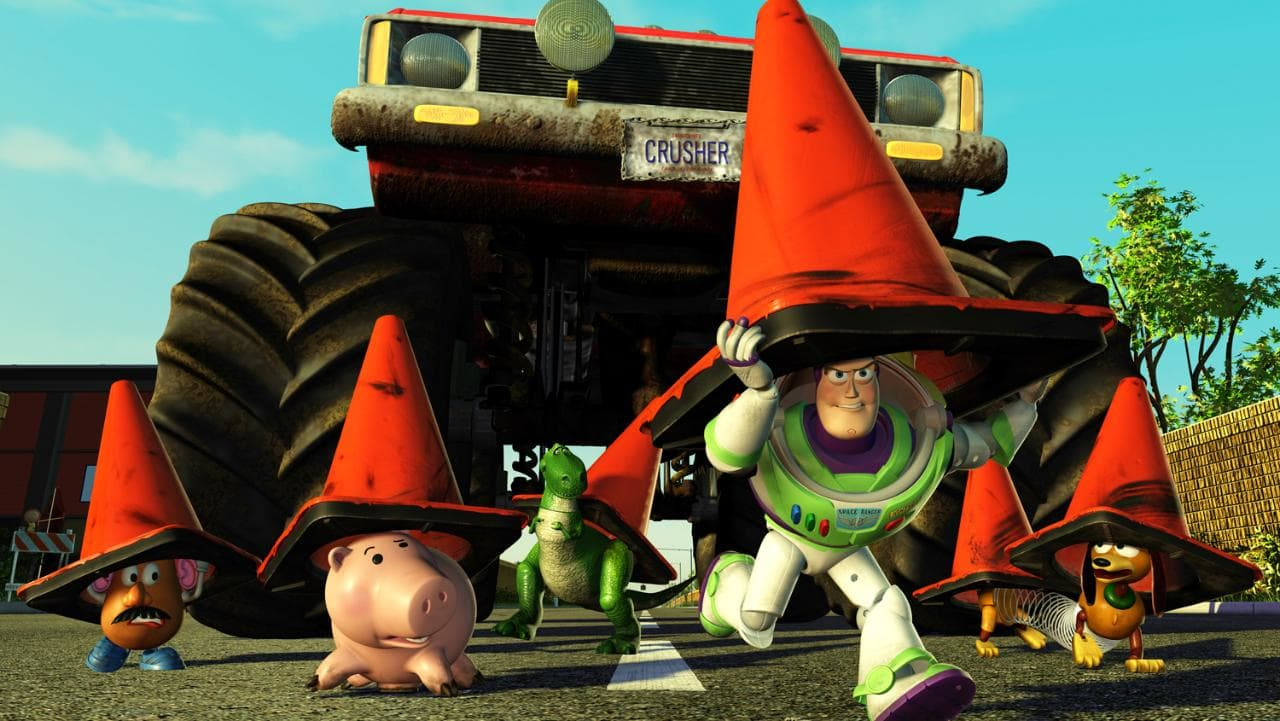 Crossing the road under traffic cones as Buzz Lightyear leads the other toys on a rescue mission in Toy Story 2 (1999)