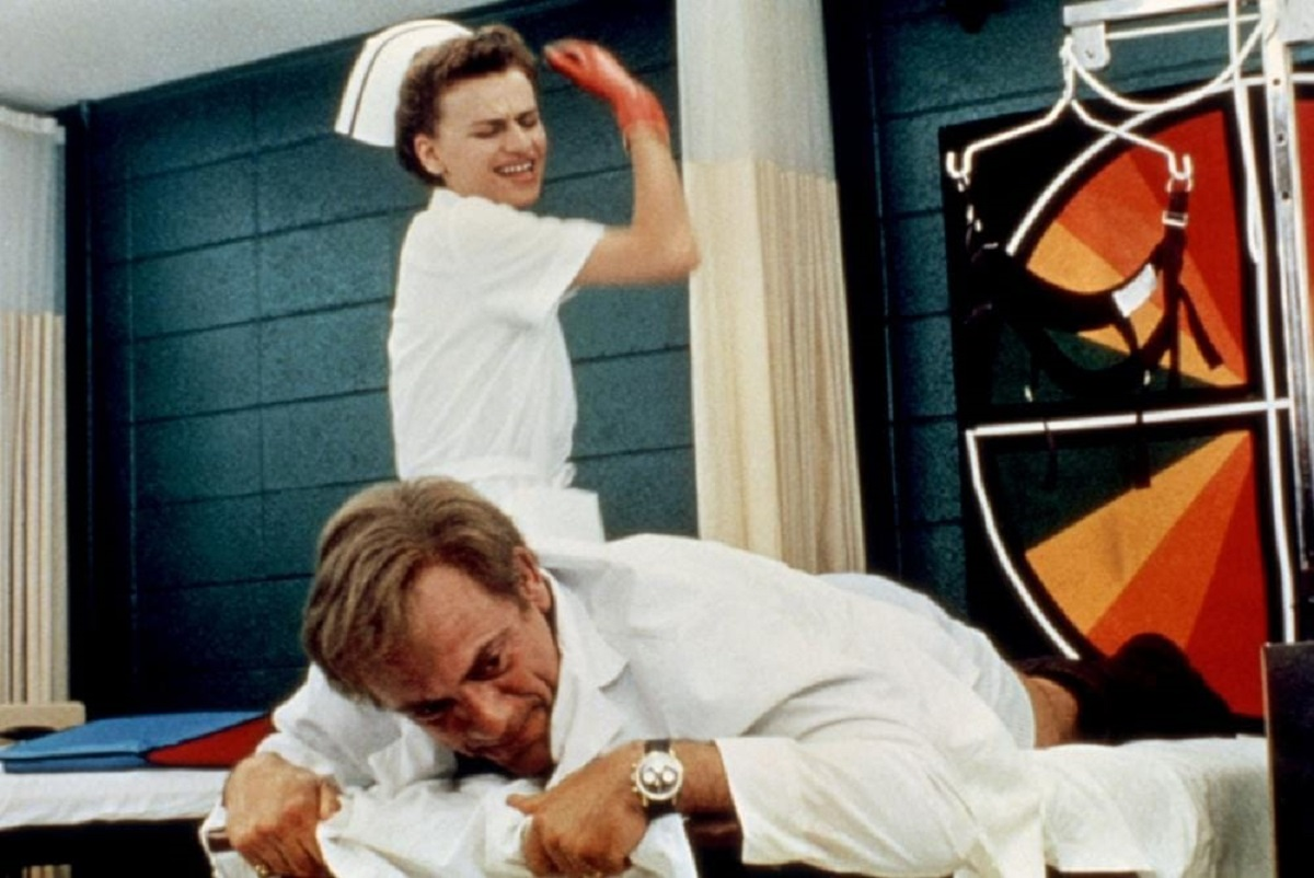 Christopher Lloyd receives a spanking from his nurse Sandra Bernhard in Track 29 (1988)