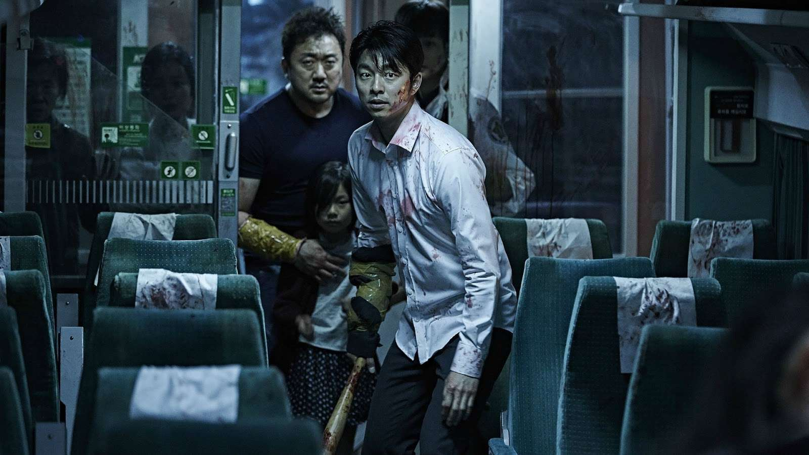 (front to back) father Yoo Gong, daughter Soo-an Kim and Dong-seok Ma venture forward to tackle the zombies in Train to Busan (2016)
