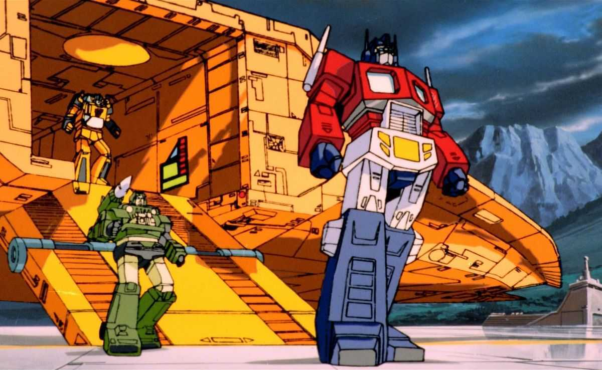 Optimus Prime (r) leads the Autobots into action in The Transformers: The Movie (1986)