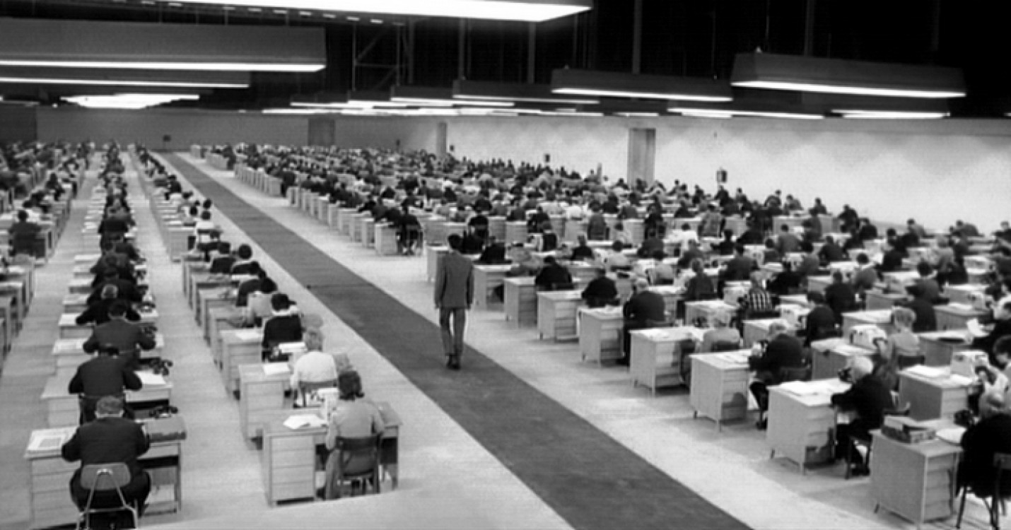 Orson Welles' use of architectural space - Anthony Perkins passes through an office filled with hundreds of secretaries in The Trial (1962)