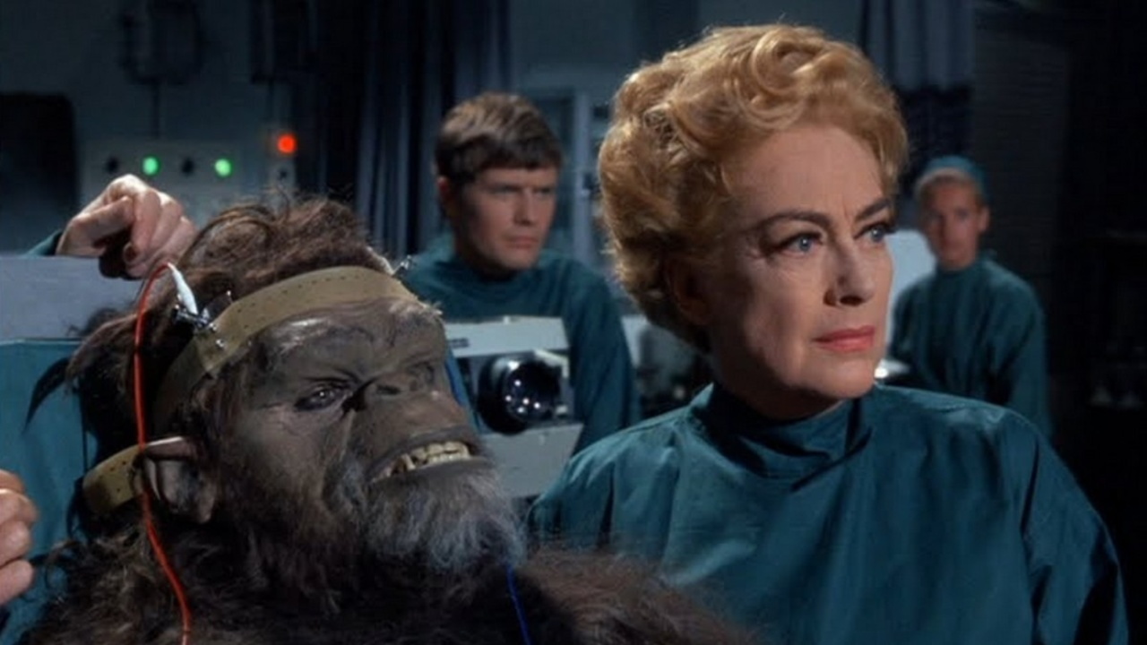 Joan Crawford and the Trog (Joe Cornelius) in Trog (1970)