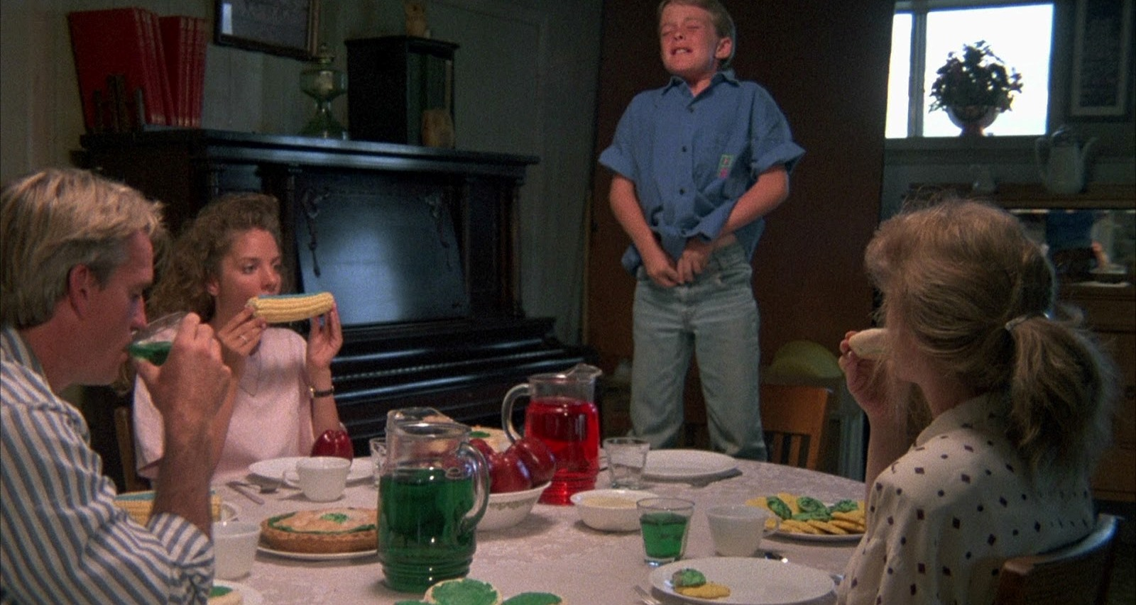 Michael Stephenson stands up to urinate on the table as father George Hardy, daughter Connie McFarland and mother Margo Prey sit down to eat dinner in Troll 2 (1990)
