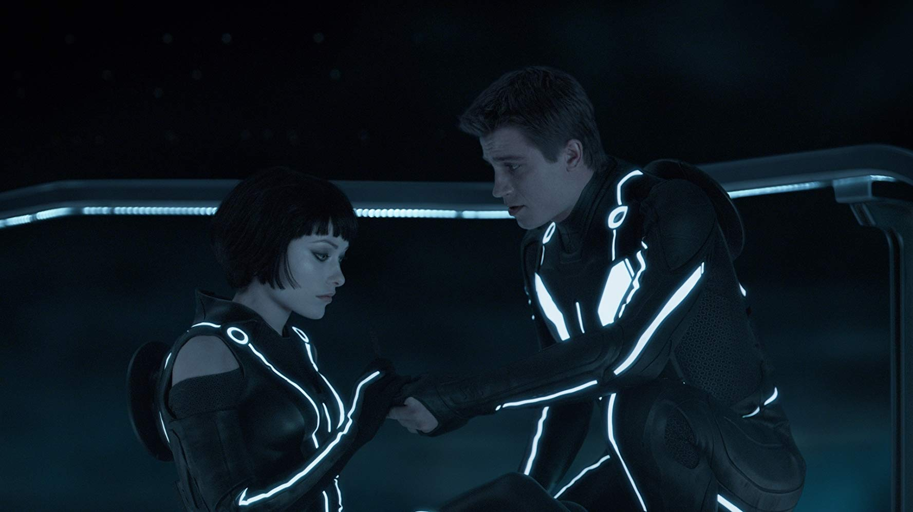 Quora (Olivia Wilde) and Garrett Hedlund as Flynn's son in Tron Legacy (2010)