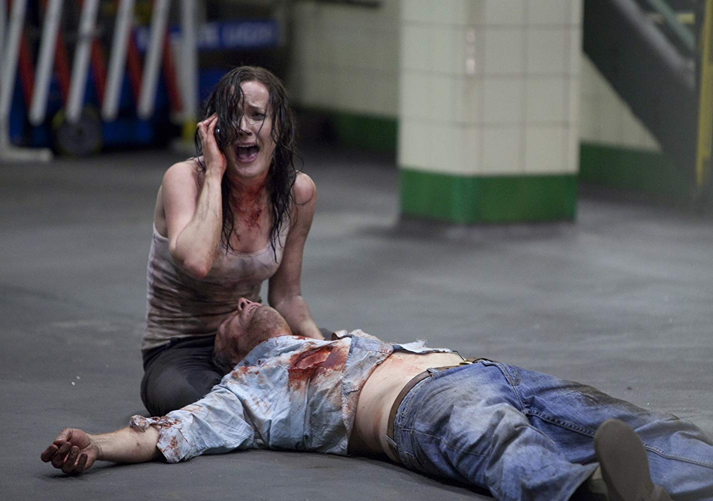 TV reporter Natasha Warner (Bel Delia) with cameraman Steve Davis (lying on ground) in The Tunnel (2011)