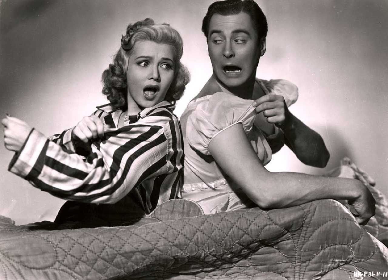 Wife Carole Landis and husband John Hubbard ends up in each other's bodies in Turnabout (1940)