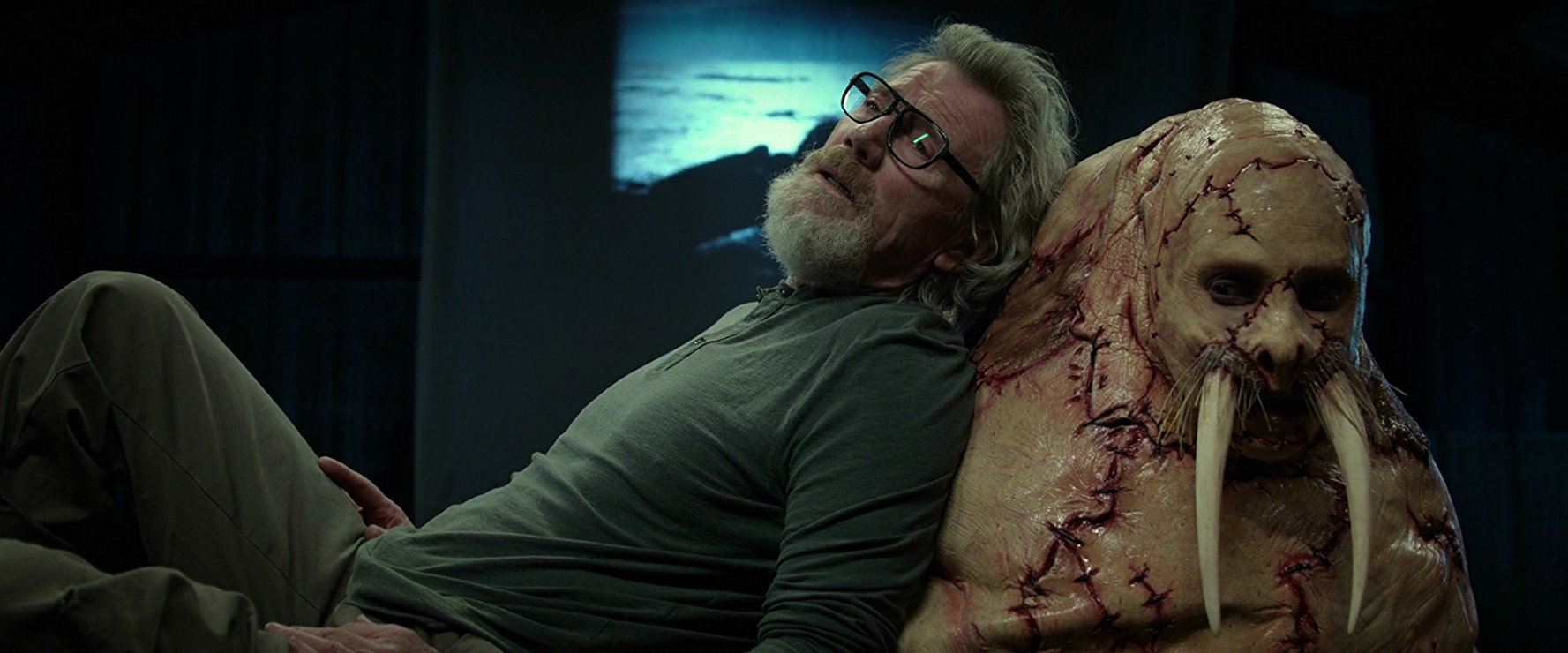 Michael Parks and Justin Long after being surgically transformed into a walrus in Tusk (2014)