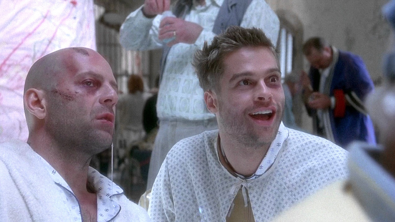 (l to r) fellow psychiatric patients Bruce Willis and Brad Pitt in Twelve Monkeys (1995)