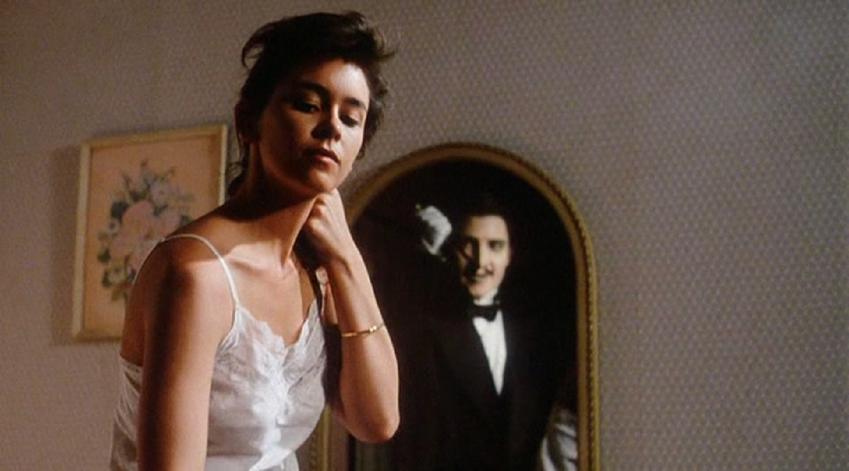 Jill Whitlow dresses while the ghost of Tyler Walker (Jonathan Chapin) lurks in the mirror in Twice Dead (1988)