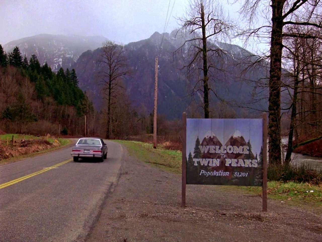 The opening credits of the tv series accompanied by Angela Badalamenti's haunting bass-line in Twin Peaks (1990)