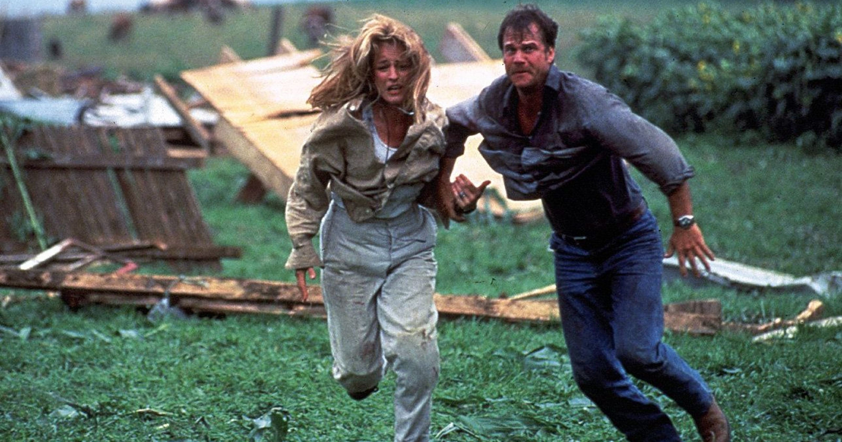 Helen Hunt and Bill Paxton flee in Twister (1996)