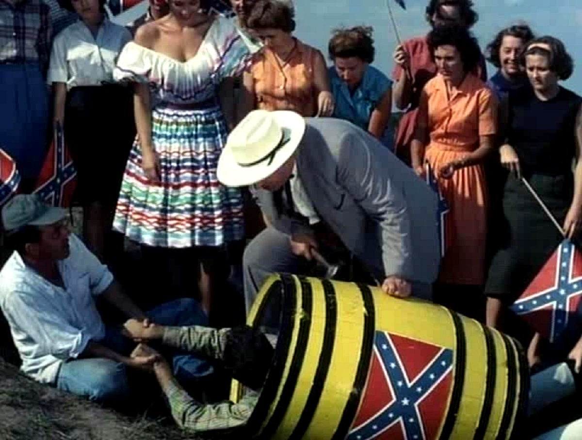 The townspeople prepare to roll a victim down a hill in a barrel of nails in Two Thousand Maniacs! (1964)