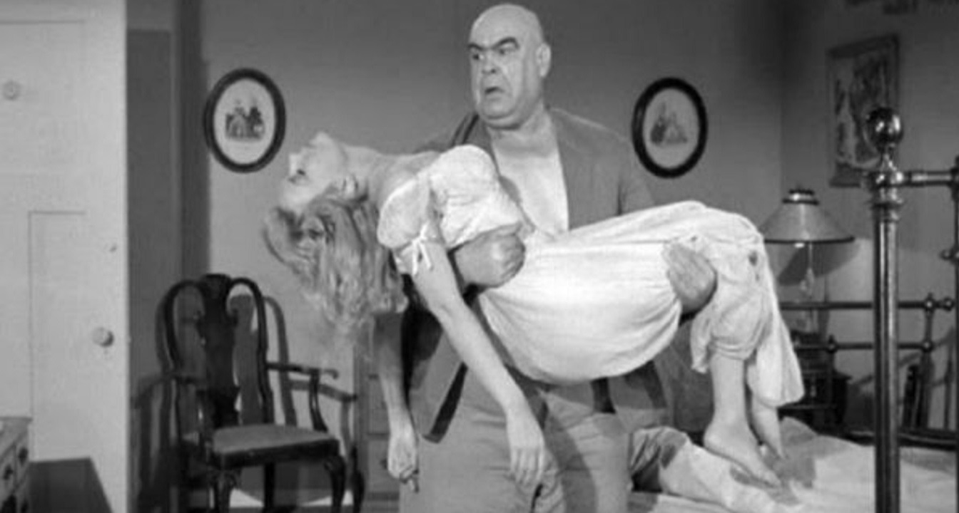 Lobo (Tor Johnson) carries off Sally Todd in The Unearthly (1957)