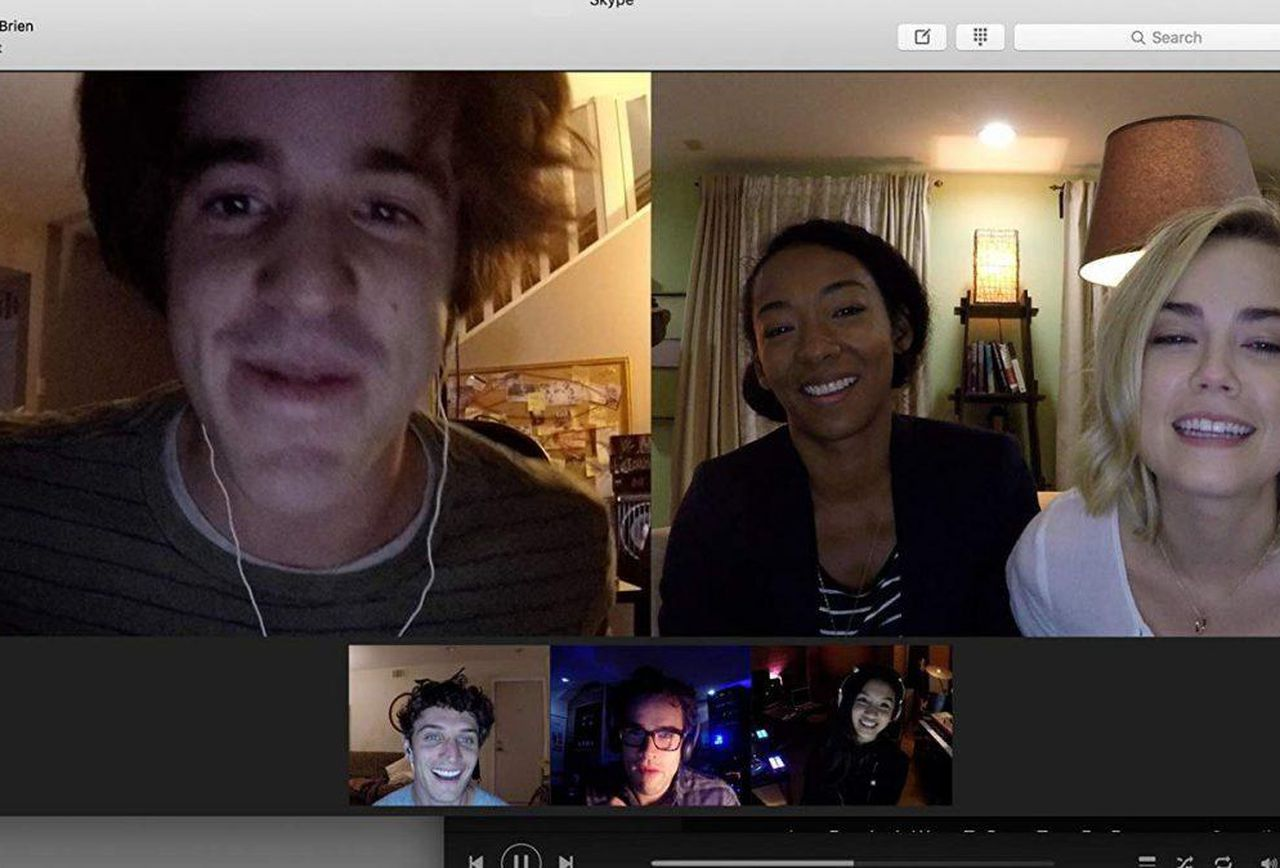 Friends gather for game night - (l to r) (top row) Connor Del Rio, Betty Gabriel, Rebecca Rittenhouse; (bottom row) Colin Woodell, Andrew Lees and Savira Windyani in Unfriended: Dark Web (2018)