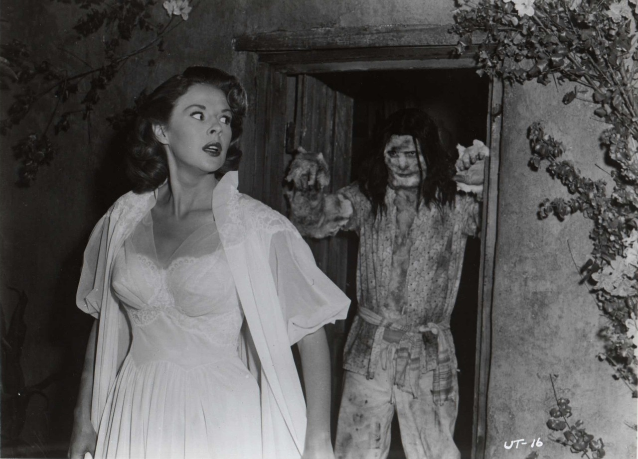 Mala Powers threatened by infected natives in The Unknown Terror (1957)