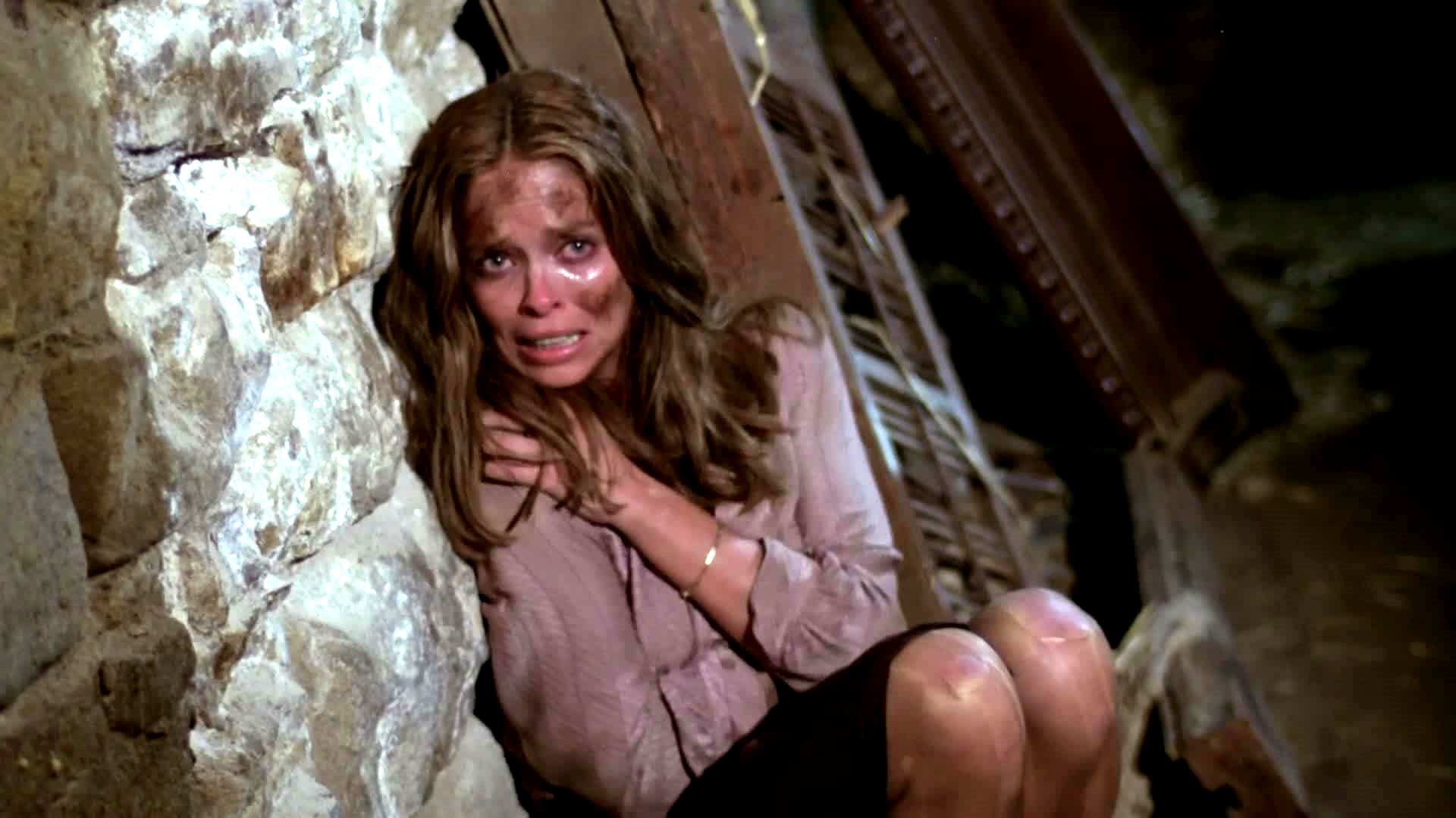 A terrified Barbara Bach tires to get away from what lurks in the cellar in The Unseen (1981)