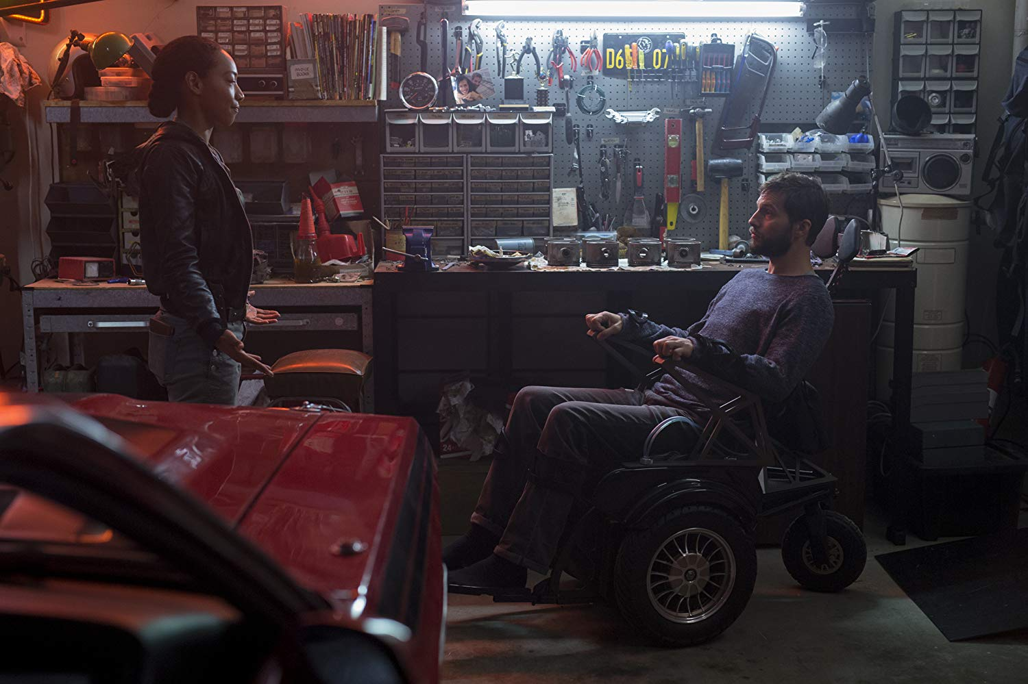 A wheelchair-ridden Logan Marshall-Green questioned by detective Betty Gabriel in Upgrade (2018)
