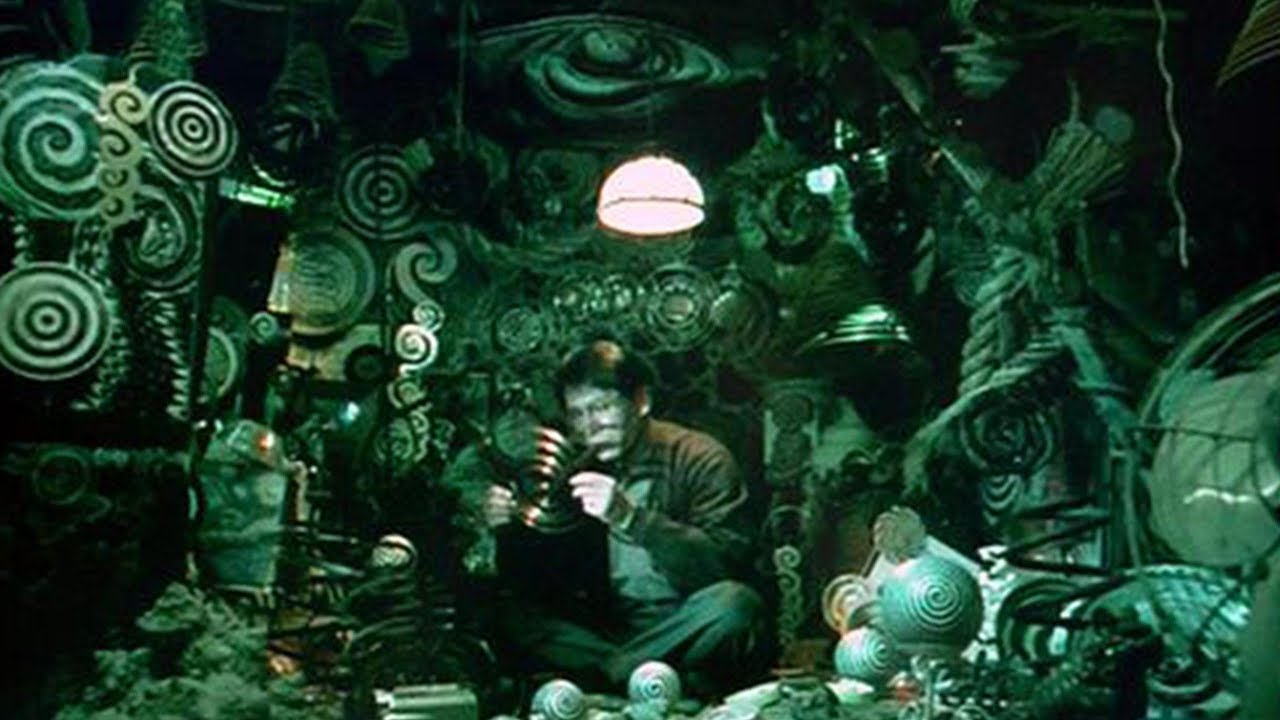 Ren Osugi surrounded by spiral patterns in Uzumaki (2000)