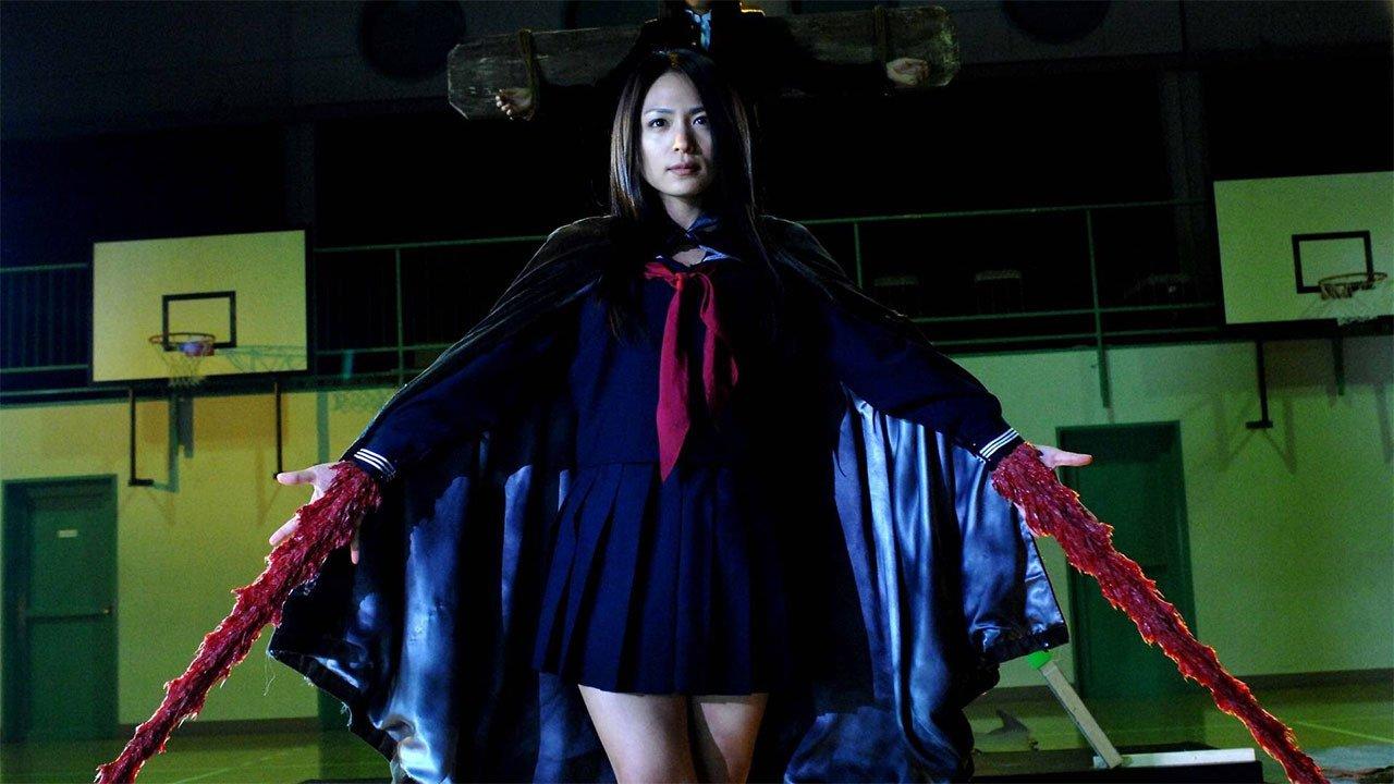 Vampire Girl Monami (Yukie Kamamura) forms swords of solidified blood from her wrists in Vampire Girl vs Frankenstein Girl (2009)