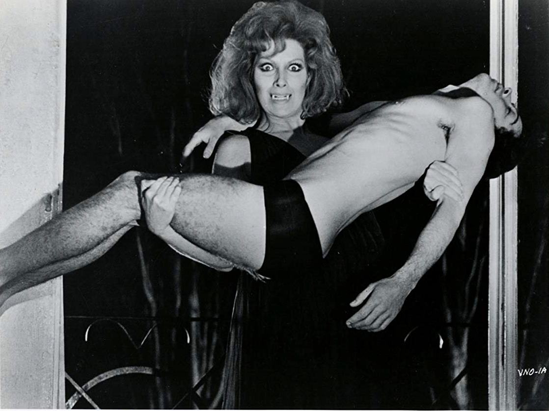 The Countess (Helga Line) and male victim in The Vampire's Night Orgy (1974)