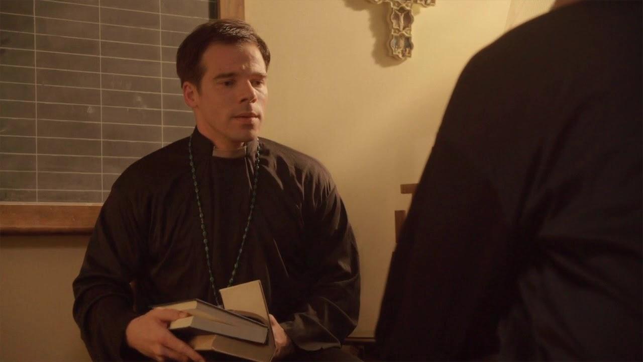 Gregory James Cohan as Father Doug Jones in The VelociPastor (2018)