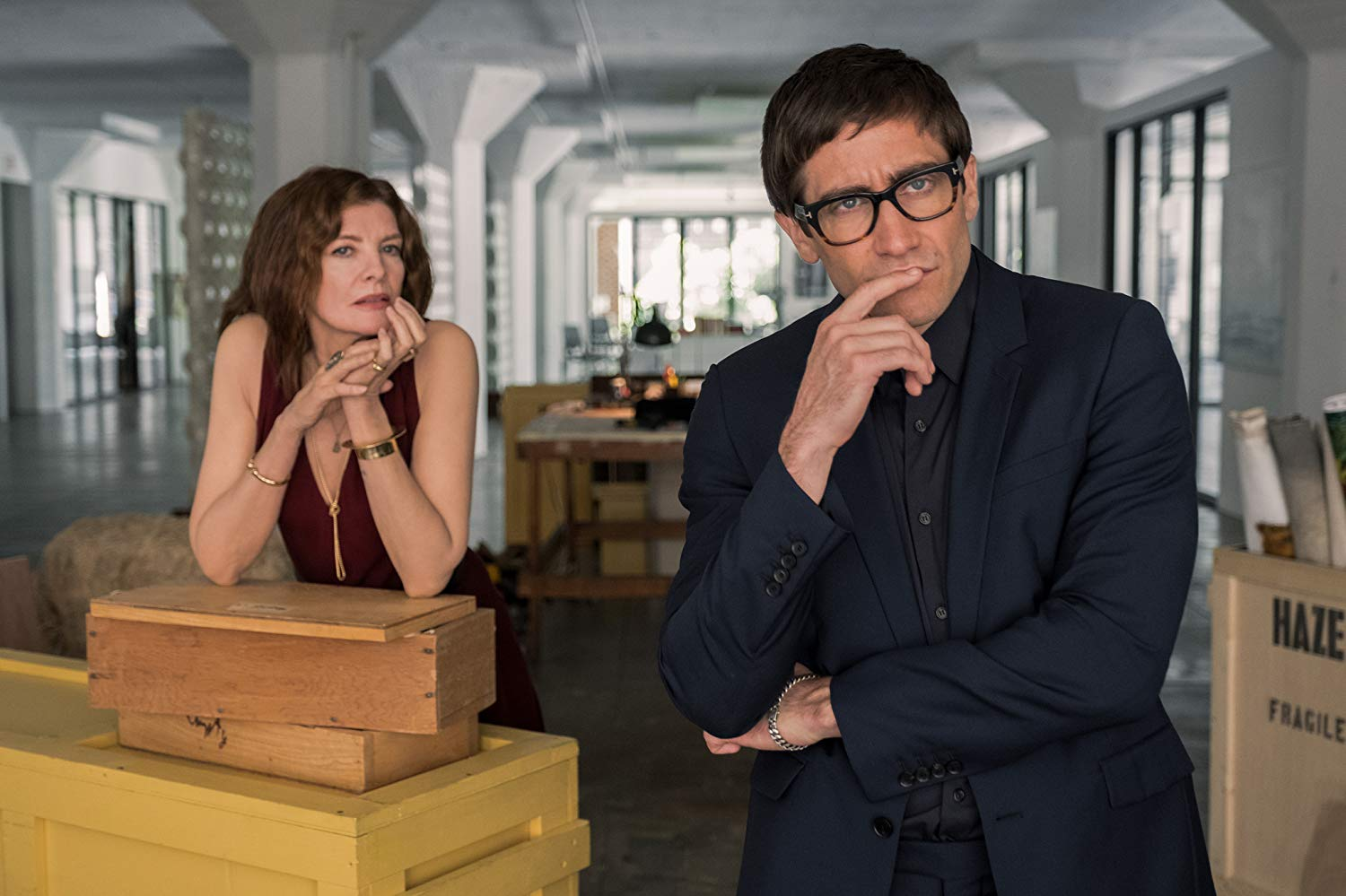 Gallery owner Rene Russo and art critic Jake Gyllenhaal peruse the paintings in Velvet Buzzsaw (2019)