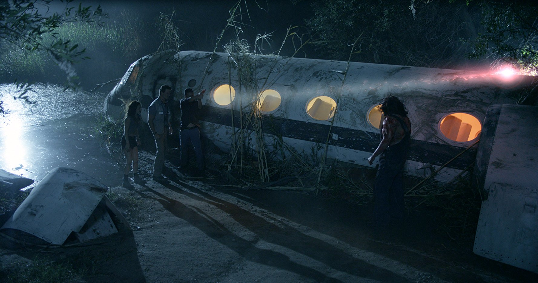 Kane Hodder prepares the slaughter survivors from a crashed plane in Victor Crowley (2017)