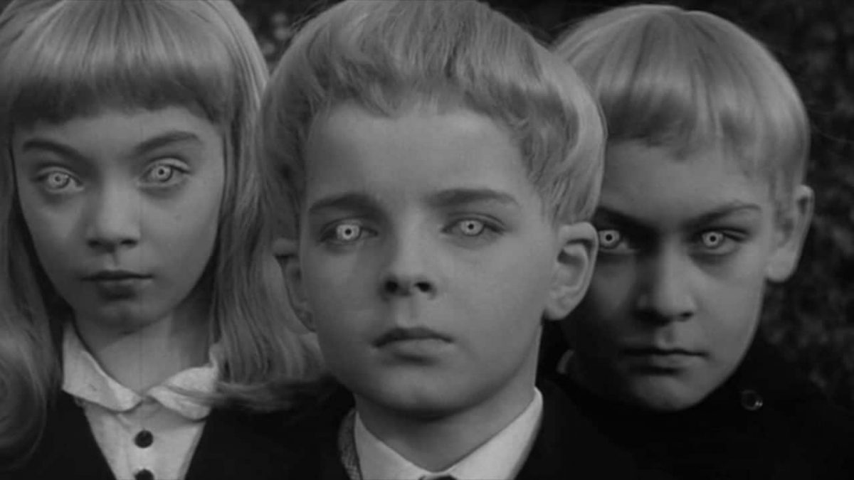 Coldly superior alien children led by Martin Stephens (c) in The children Village of the Damned (1960)