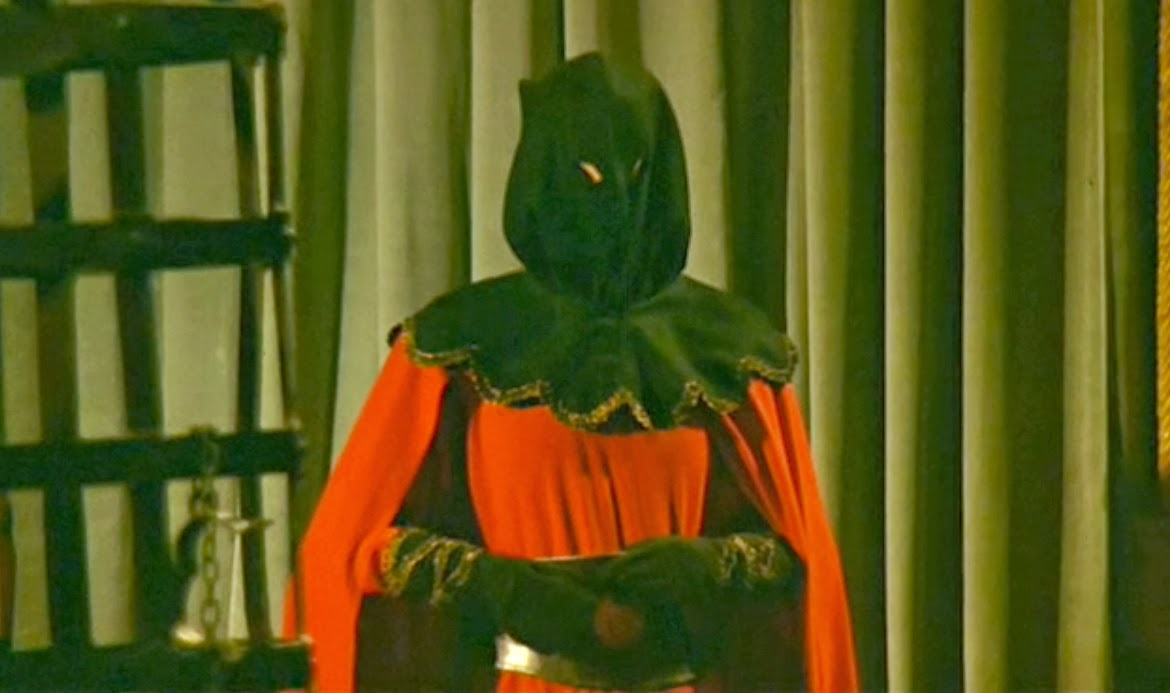 The Executioner prowls the halls in The Virgin of Nuremberg (1963)