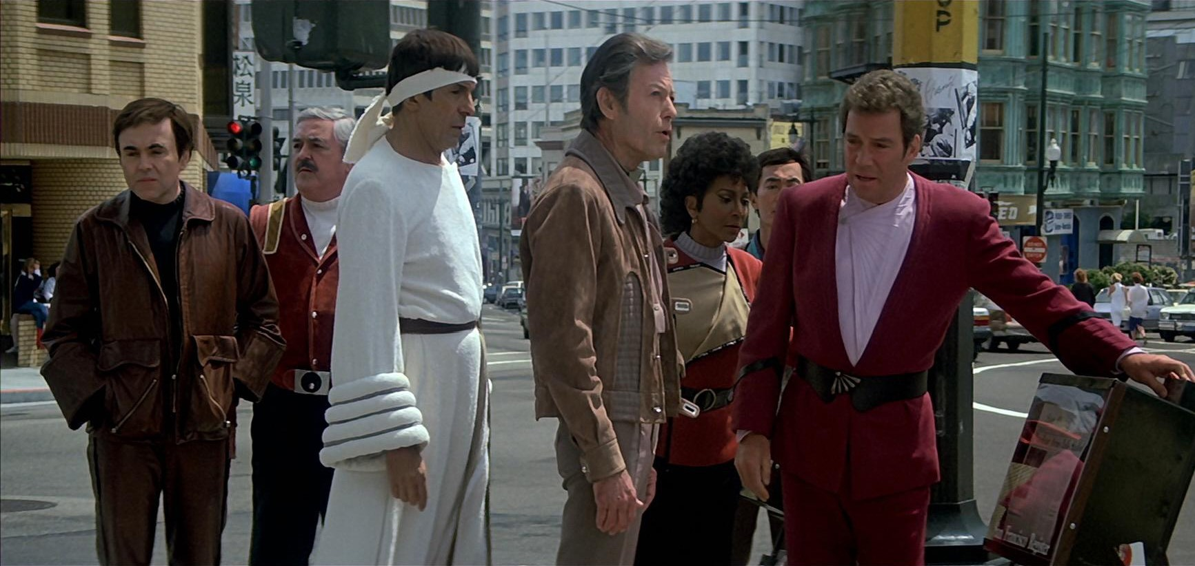 The Enterprise crew travel back to present day San Francisco - (l to r) Chekov (Walter Koenig), Mr Scott (James Doohan), Spock (Leonard Nimoy), Dr McCoy (DeForest Kelley), Uhura (Nichelle Nichols), Sulu (George Takei) and Captain Kirk (William Shatner) in The Voyage Home: Star Trek IV (1986)