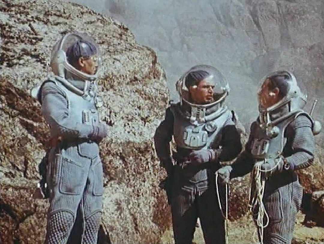 The astronauts explore Venus in Voyage to the Prehistoric Planet (1965)