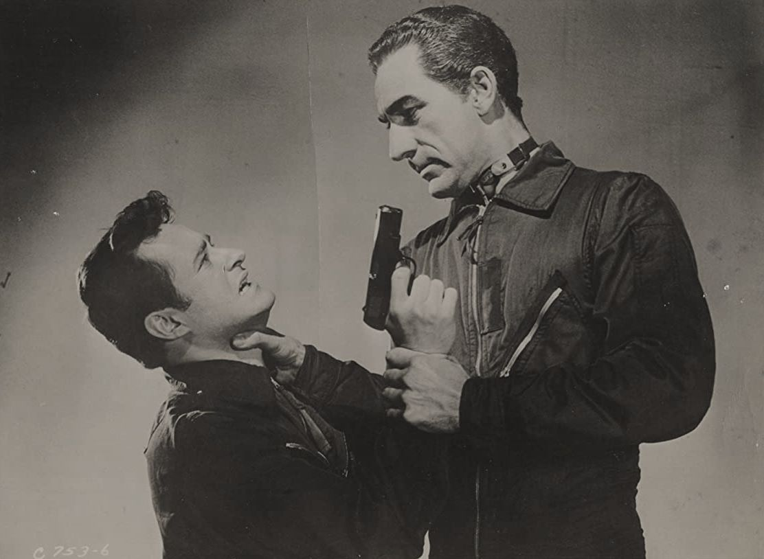 Dick Miller fights off the alien-possessed Richard Devon in War of the Satellites (1958)