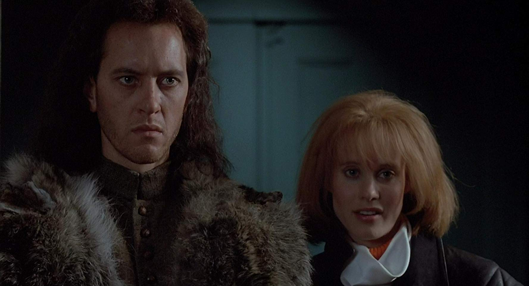 Time-travelling witchfinder Giles Redferne (Richard E. Grant) and modern girl Kassandra (Lori Singer) in Warlock (1989)