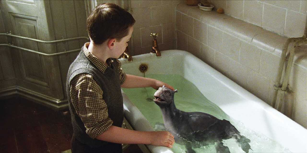 Young Angus MacMorrow (Alex Etel) with The Water Horse (2007)