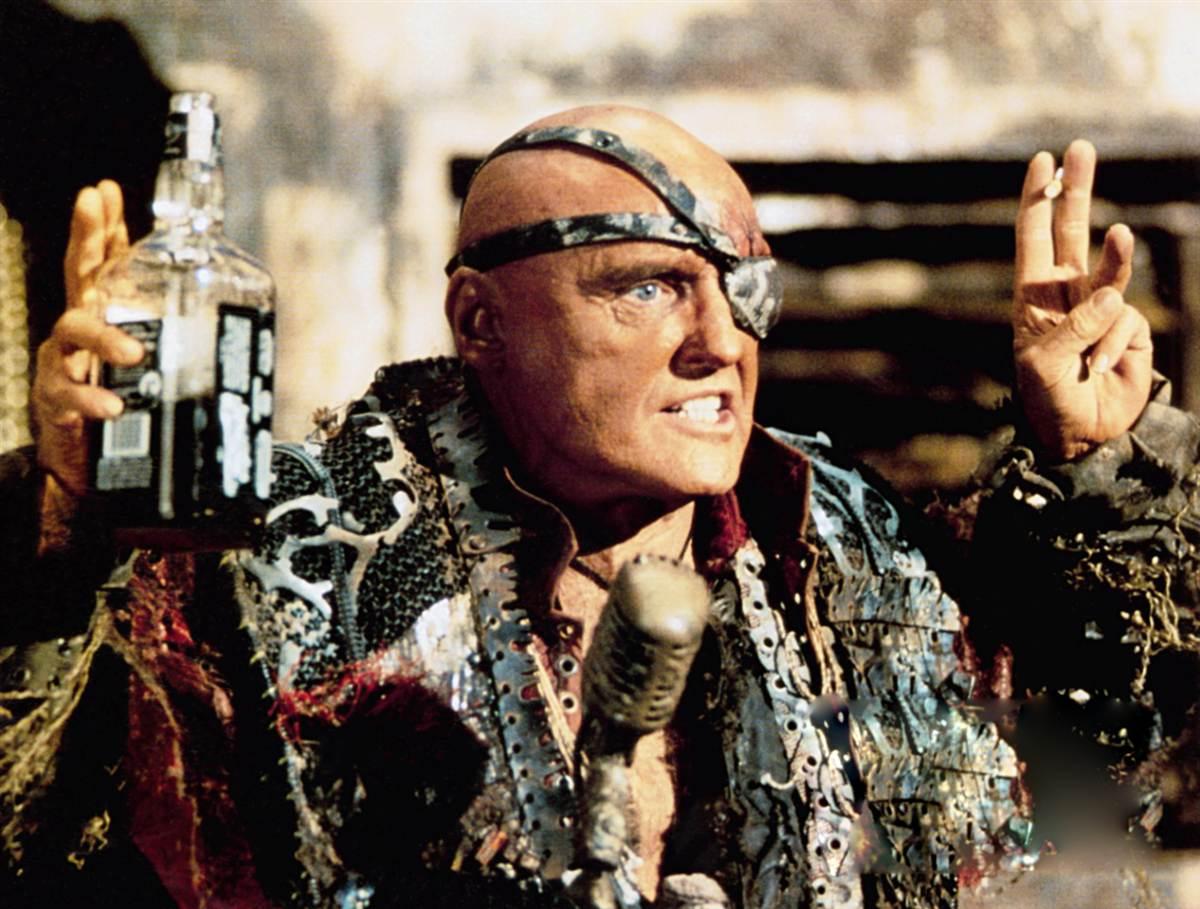 Dennis Hopper as The Deacon in Waterworld (1995)