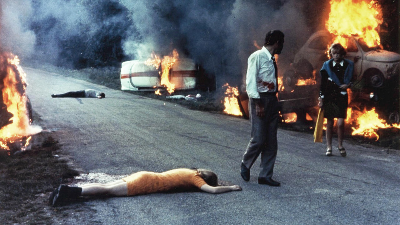 Jean Yanne and Mireille Darc pass through a traffic jam that becomes increasingly more apocalyptic in Weekend (1967)