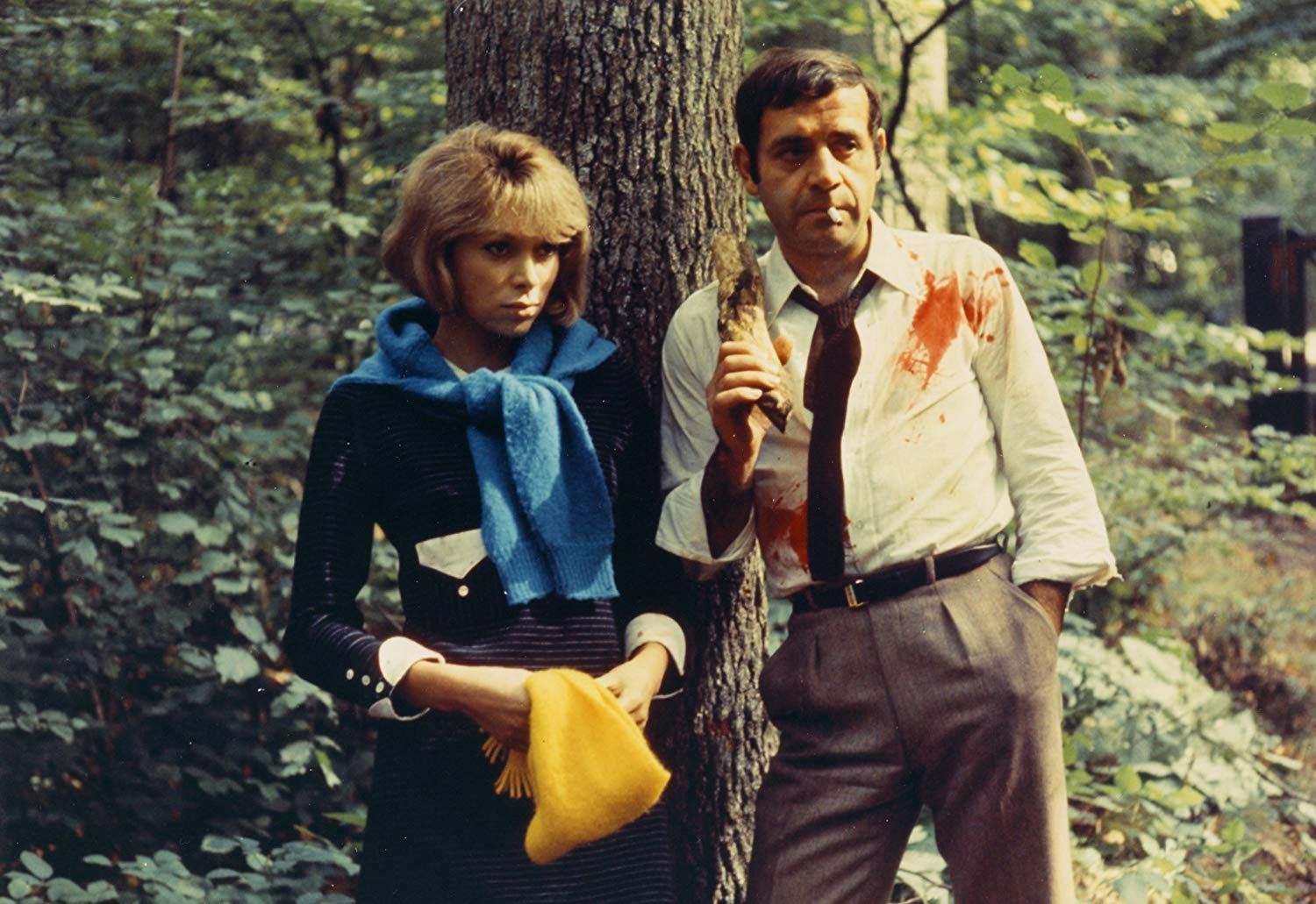 Husband and wife Jean Yanne and Mireille Darc on a weekend journey into the countryside in Weekend (1967)