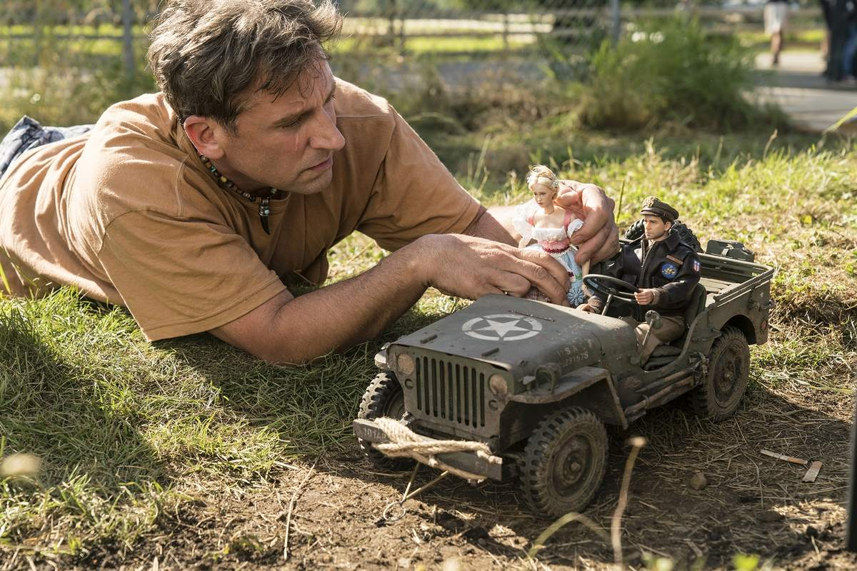Mark Hogancamp (Steve Carell) at work on construction of his model village in Welcome to Marwen (2018)
