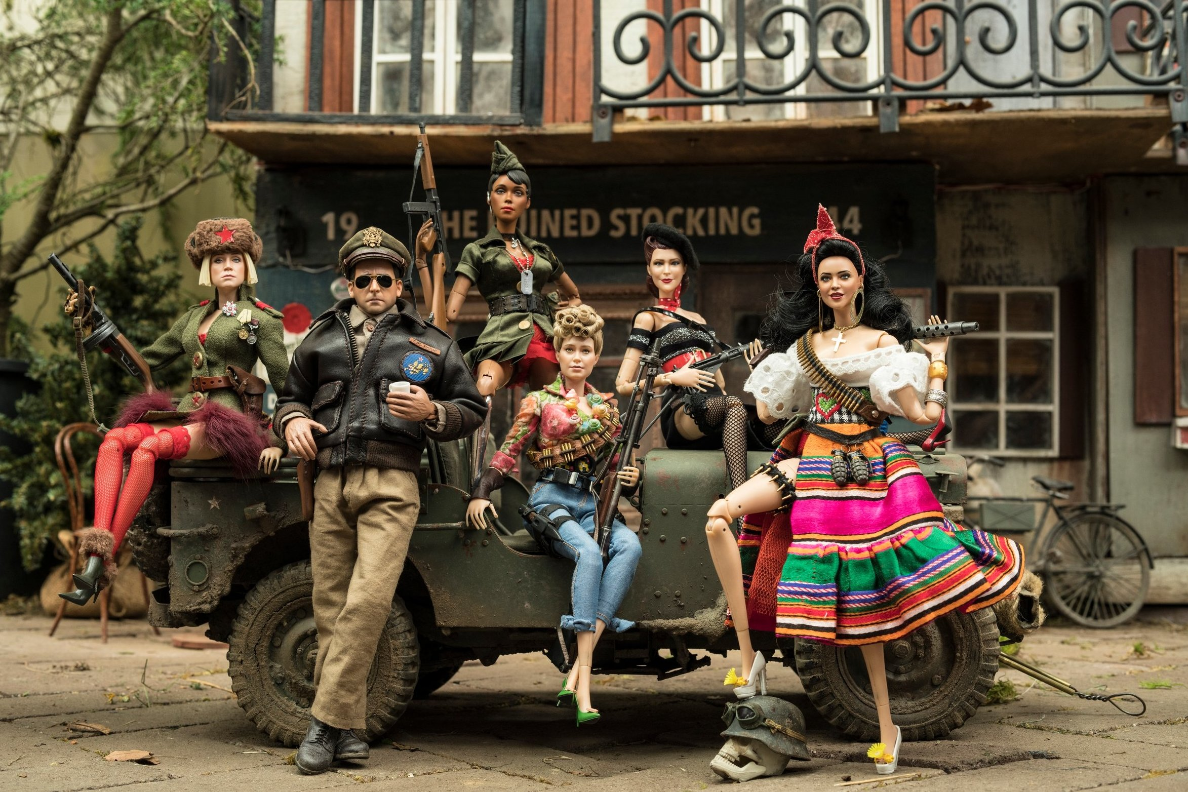 The village of Marwen with Cap'n Hogie surrounded by his army of women in Welcome to Marwen (2018)
