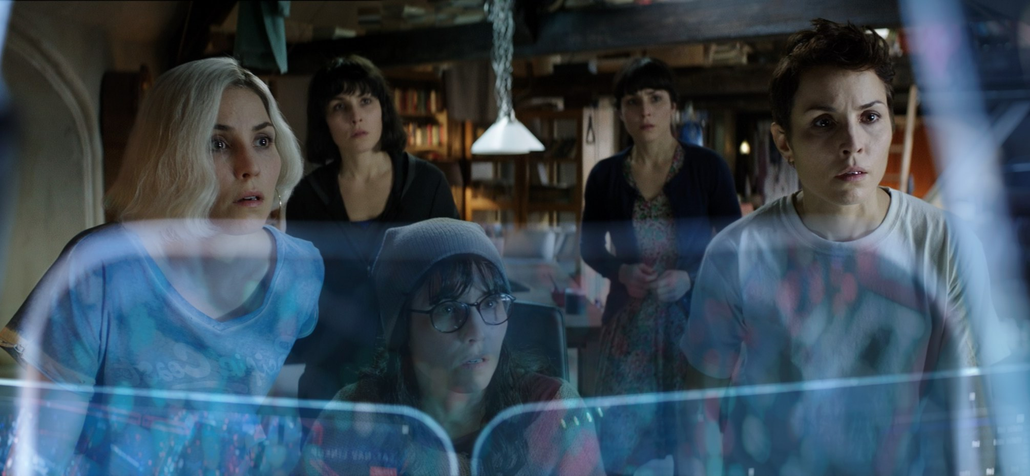 Noomi Rapace as five of the seven sisters as they set out to outwit the system in What Happened to Monday (2017)