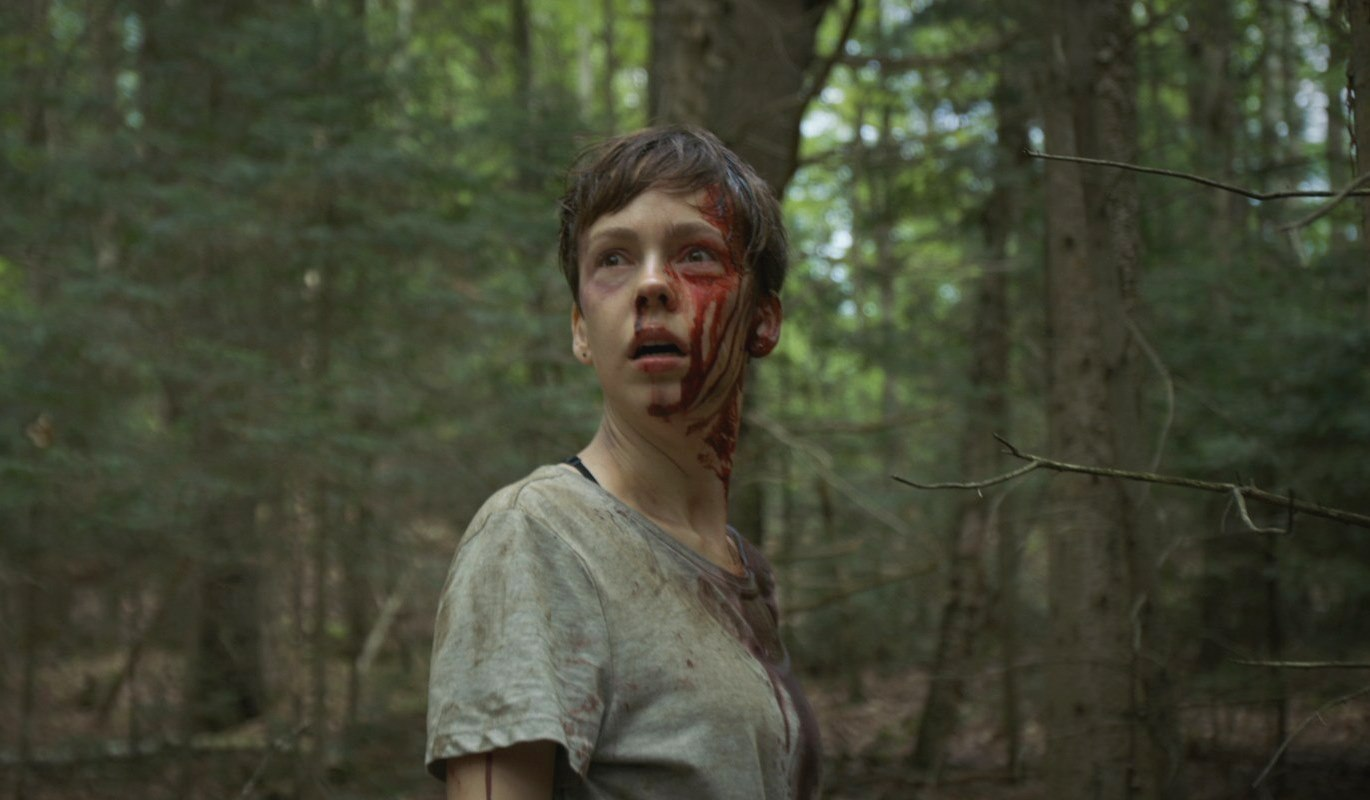 Brittany Allen hunted through the woods in What Keeps You Alive (2018)