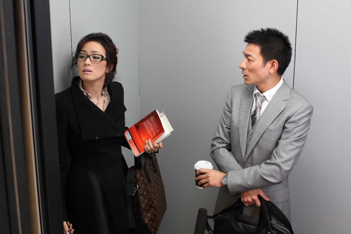 Andy Lau (r) as the ad agency executive who gains the ability to read women's minds and Gong Li (l) as his romantic rival in What Women Want (2011)