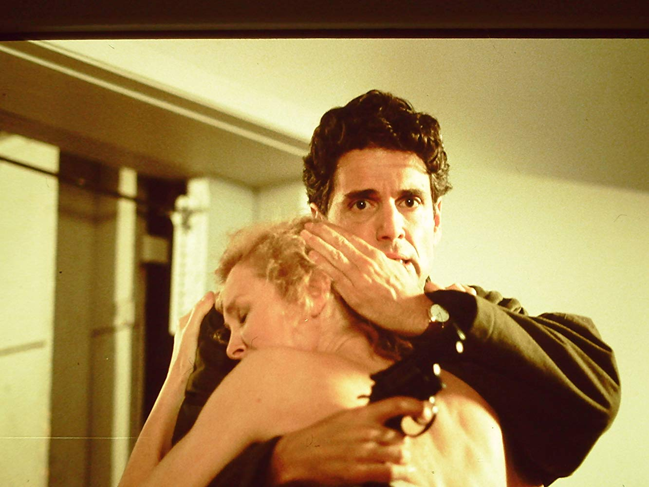 Police detective Chris Sarandon comforts writer Hilary Thomas (Victoria Tennant) in Whispers (1990)